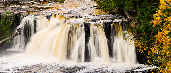 Waterfall Photography Tips. Manabezho waterfalls in Porcupine Mountains Wilderness Park in Upper Peninsula, Michigan.