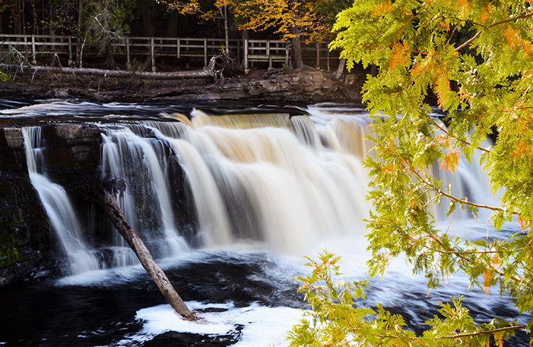 Manual Mode and Slow Shutter Speed gives milky effect to Manabezho waterfalls in Porcupine Mountains