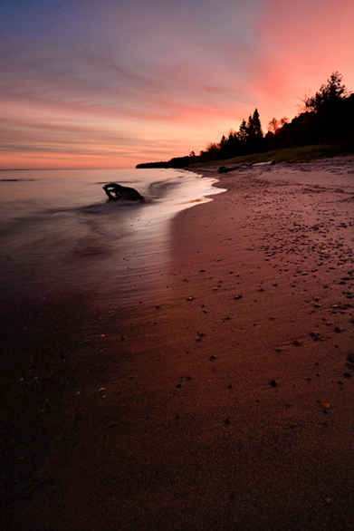 Leading Line combined with Rule of Thirds Photography Composition Technique. Sunrise in Lake Superior, Upper Peninsula, Michigan.