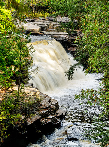 Nature Photography Simplified. Shutter Speed. Canyon Waterfalls in Upper Michigan framed in natural trees.